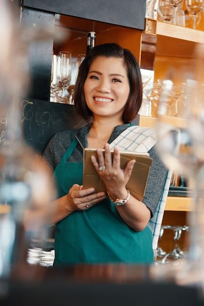 Pretty smiling bartender Free Photo