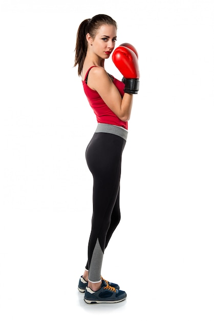 Pretty sport woman with boxing gloves Premium Photo