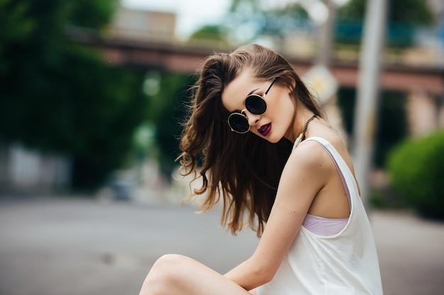 Pretty teen with sunglasses Free Photo