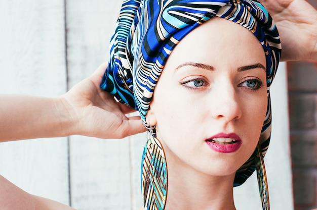 A pretty woman in a blue headscarf in an african manner Premium Photo
