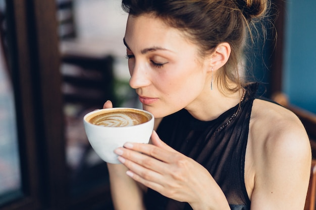 Pretty woman drinking coffee Free Photo