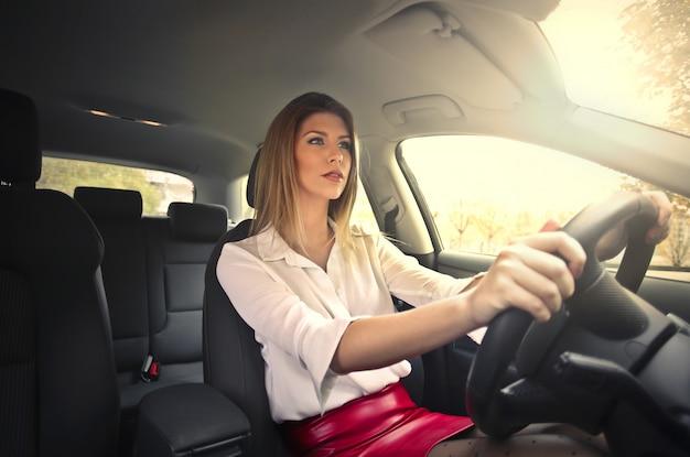Pretty woman driving a car Premium Photo