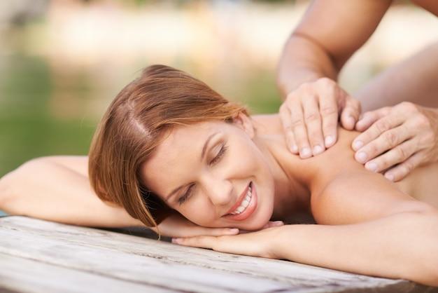 Pretty woman enjoying her massage Free Photo