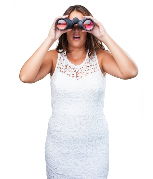 Pretty woman looking through binoculars Photo | Free Download