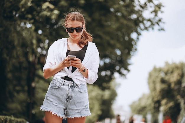Pretty woman outside the street using phone Free Photo