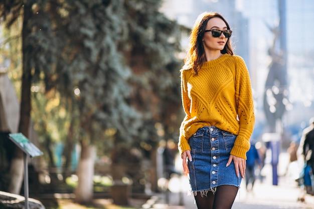 Pretty woman posing in an autumn street Free Photo