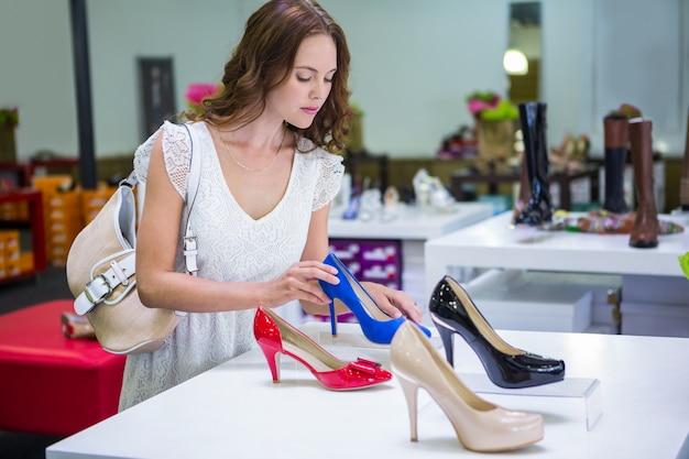 Premium Photo   Pretty woman shopping for shoes
