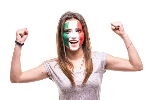 Pretty woman supporter fan of mexico national team painted flag face get happy victory screaming into a camera. fans emotions. Free Photo