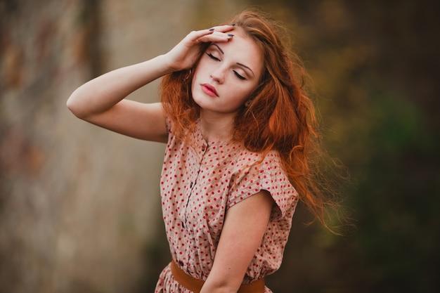 Pretty woman touching her face Premium Photo