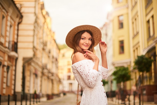 Pretty woman tourist walks in old center and admires the sights Premium Photo
