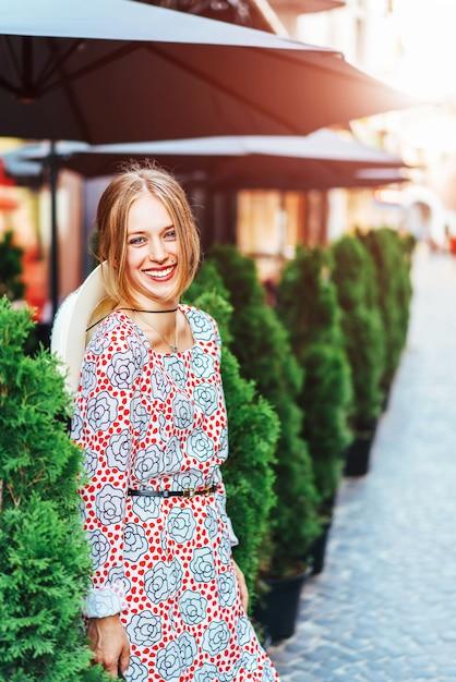 Pretty woman walking outdoor on the street Premium Photo
