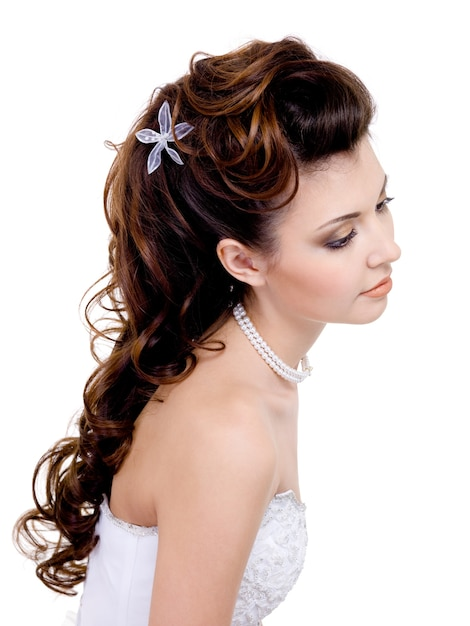 Pretty  woman with beautiful wedding hairstyle, long curly hairs  isolated on white Free Photo