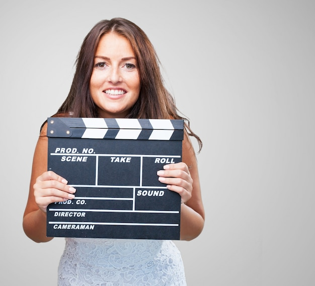 Pretty woman with a clapper Free Photo