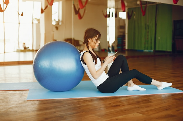 Pretty woman with fitball Free Photo
