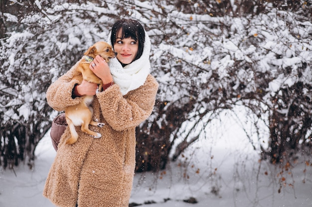 Pretty woman with her little cute pet dog Free Photo