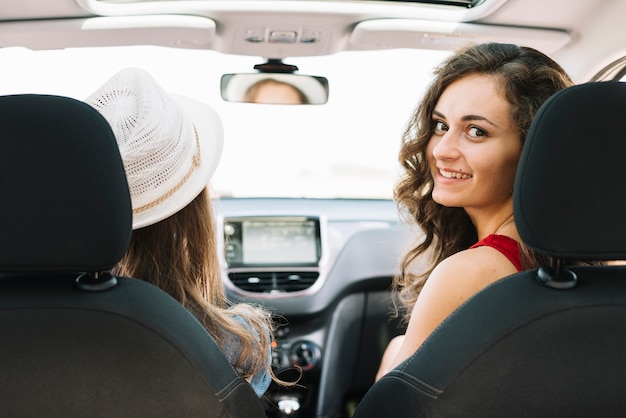 Pretty women sitting in car and driving Free Photo
