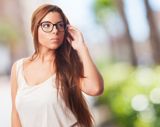 Pretty young girl wearing glasses. Free Photo