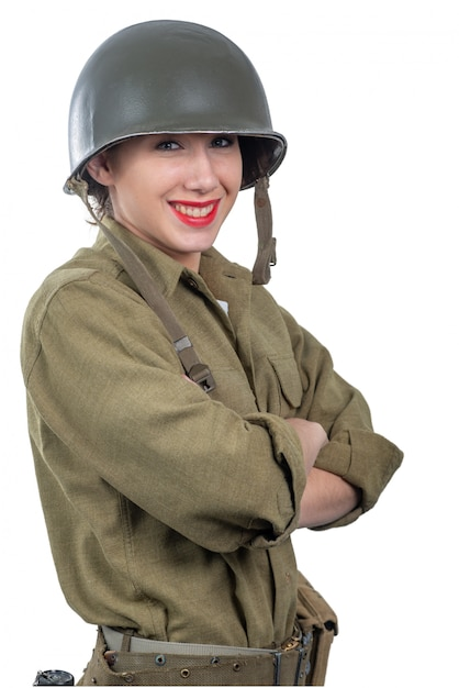Pretty young woman dressed in american ww2 military uniform with m1 helmet Premium Photo