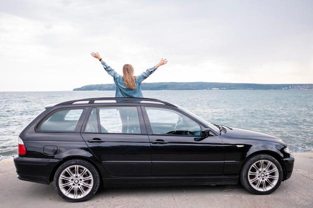 Pretty young woman enjoying road trip Premium Photo