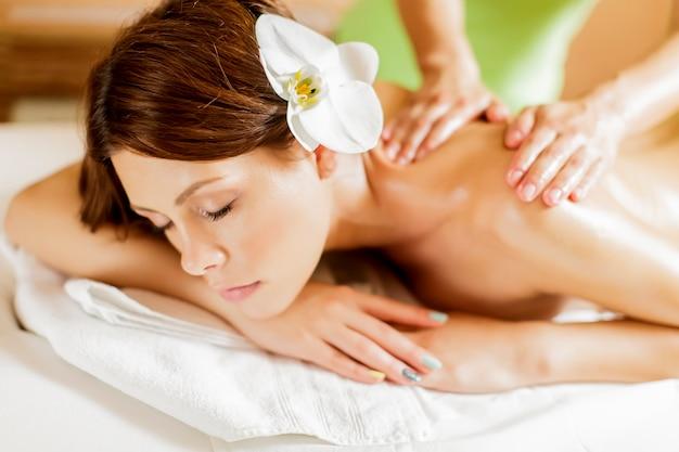 Pretty young woman having a massage Premium Photo