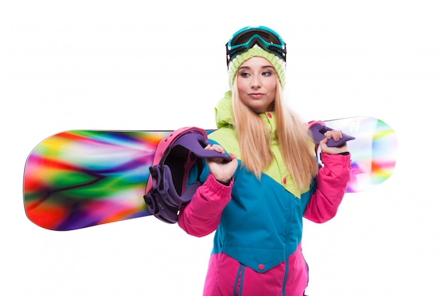 Pretty young woman in ski outfit and ski glasses hold snowboard Premium Photo