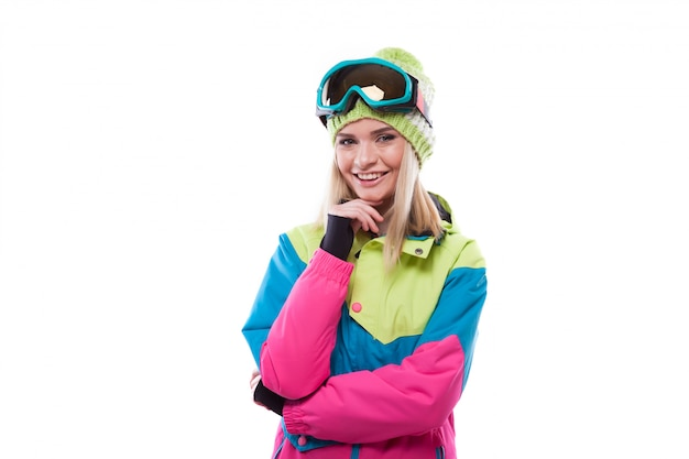 Pretty young woman in ski outfit Premium Photo