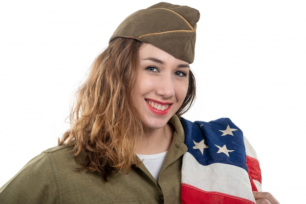 Pretty young woman in ww2 uniform us with american flag Premium Photo