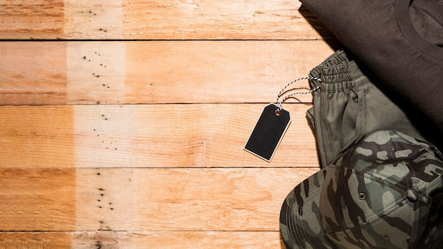 Price tag on male clothing over the wooden desk Free Photo