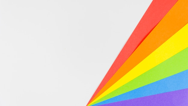 Pride flag with colorful paper sheet Free Photo