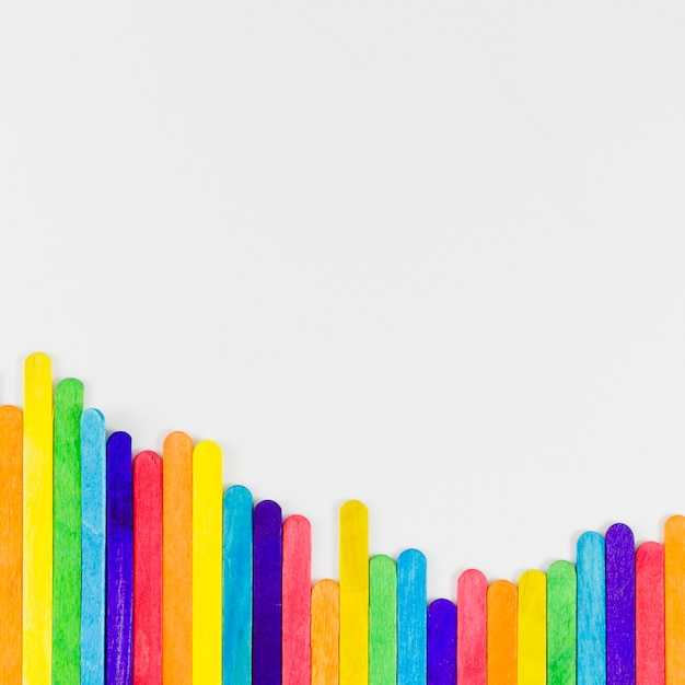 Pride flag with colorful sticks Free Photo