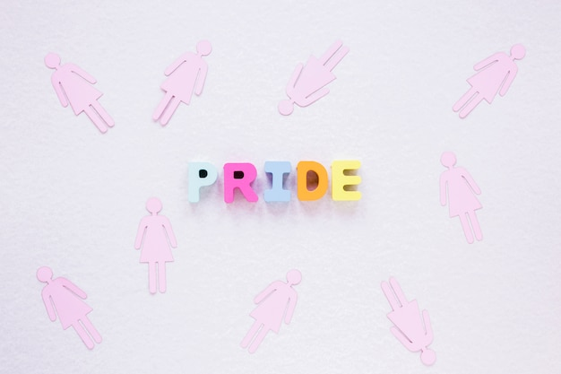 Pride inscription with female gender icons Free Photo