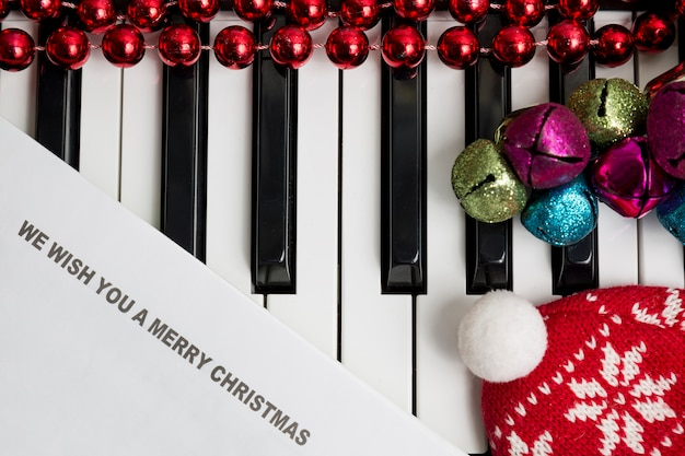 Printed lyrics on the pianto with jingle bells Premium Photo