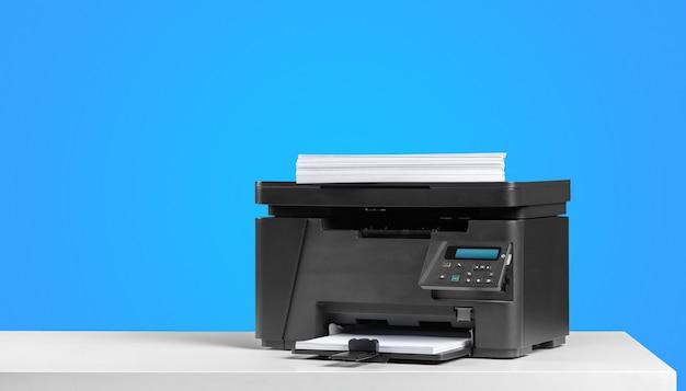 Printer copier machine on a bright colored background Premium Photo