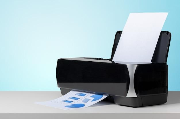 Printer on white desk Premium Photo
