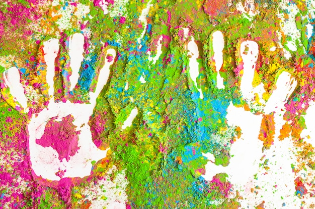 Prints of palms on stains of bright dry colors Free Photo