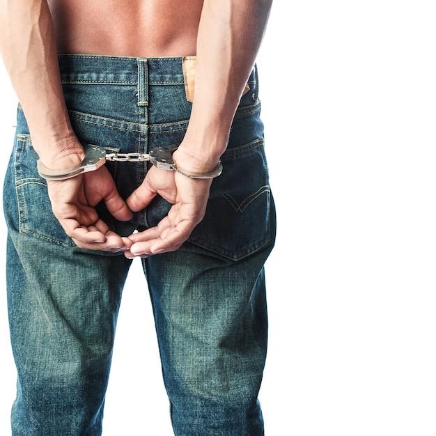 Prisoner locked in handcuffs Premium Photo