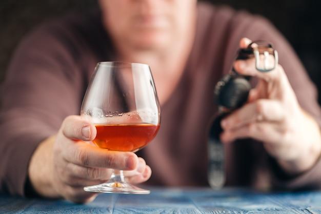 Problem of alcoholism, man stop drinking more Premium Photo