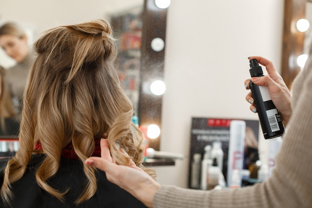 The process of cutting and styling women hair in the salon Premium Photo