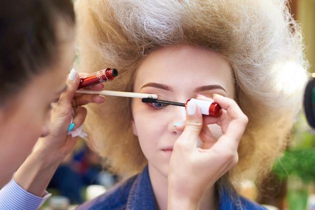 The process of professional makeup. Premium Photo