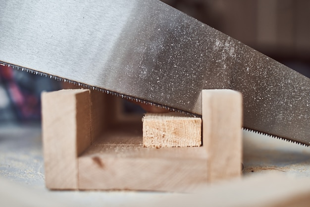 Process of sawing wooden board. concept of diy woodwork and furniture making Premium Photo