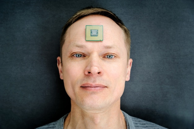 Processor is on the man's forehead. Premium Photo