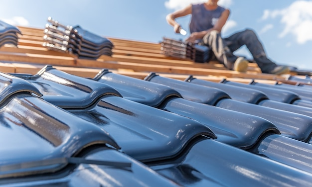 Production of roofs from ceramic fired tiles on a family house Premium Photo
