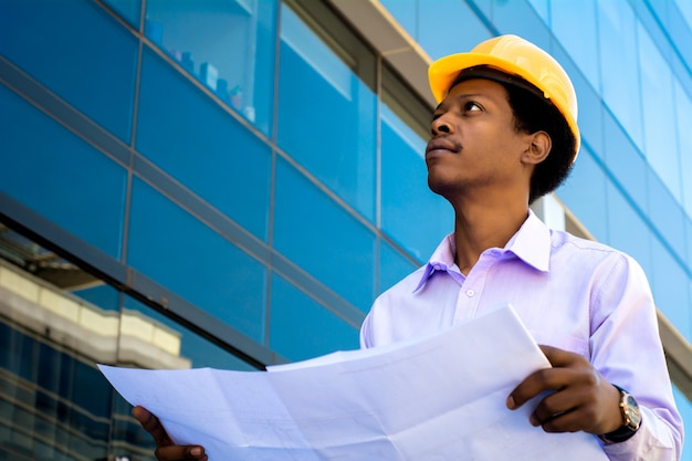 Professional architect in helmet looking away Premium Photo