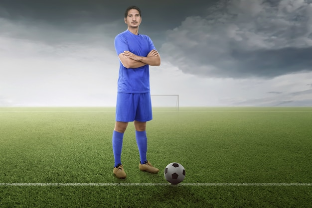 Professional asian football player with ball ready for play the match Premium Photo