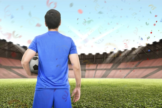 Professional asian soccer player holding the ball Premium Photo