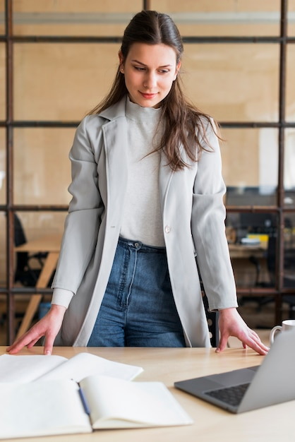 Professional attractive businesswoman looking at laptop in ...