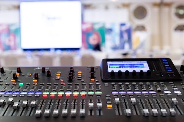 Professional audio sound mixing console faders in seminar room. Premium Photo