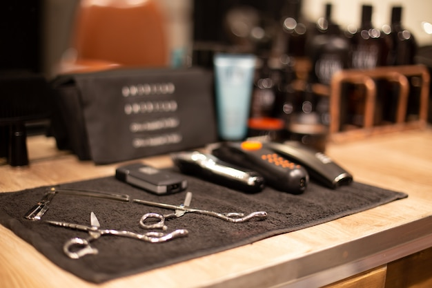 Professional barber tools in barbershop on blurred background Premium Photo