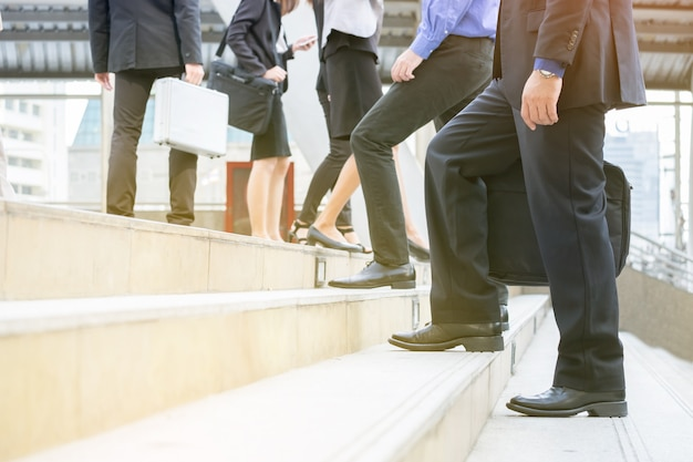 Professional business people, officer, employee walk on stair for work, appointment meeting in rush Premium Photo