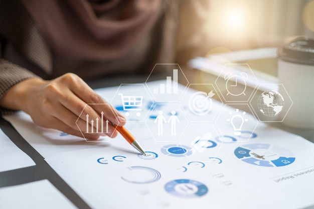 Professional businesswoman checking in financial investment project graph chart report Premium Photo